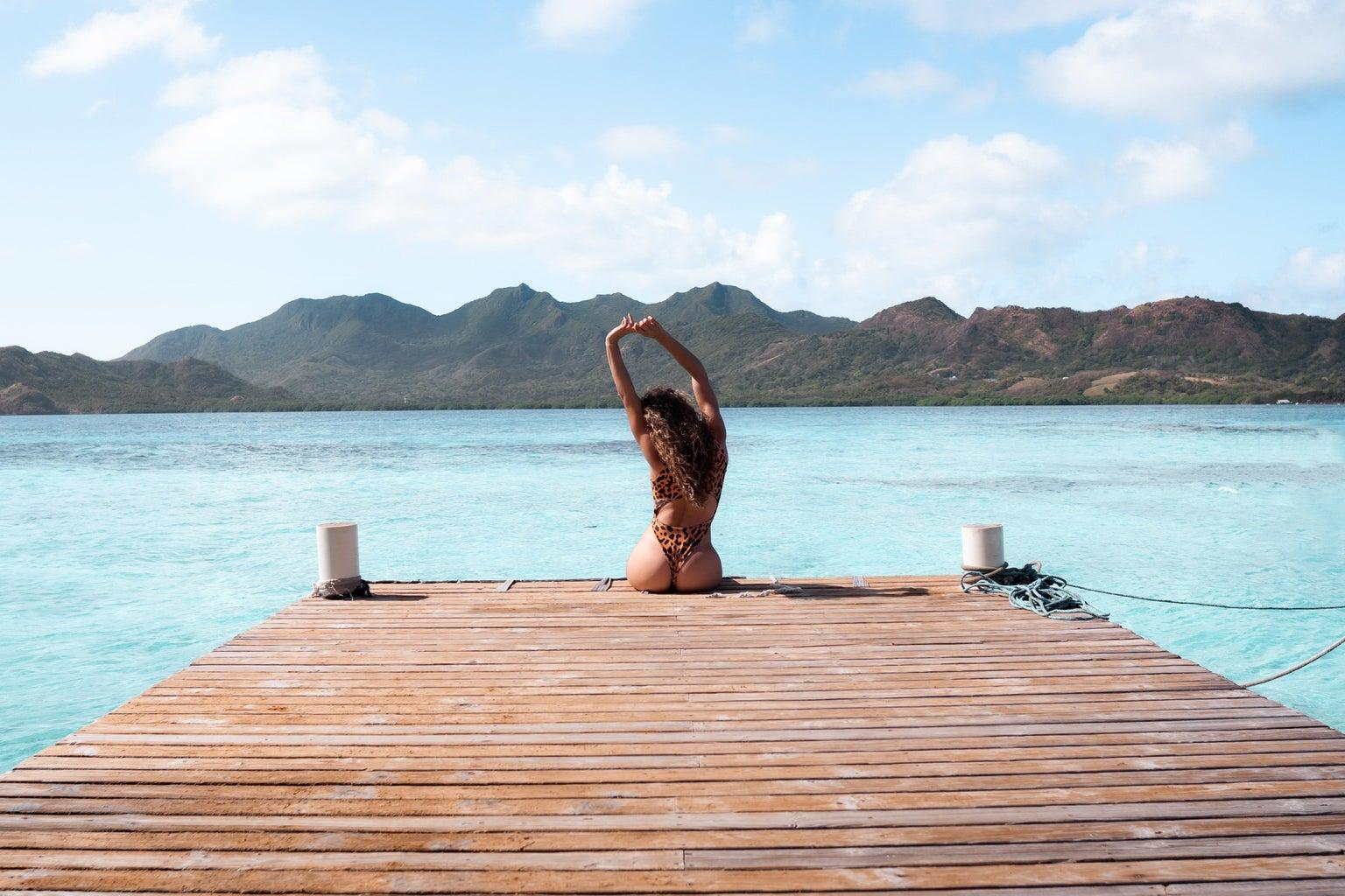 woman sitting on wooden dock