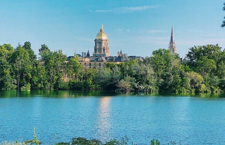 notre dame golden dome across lake