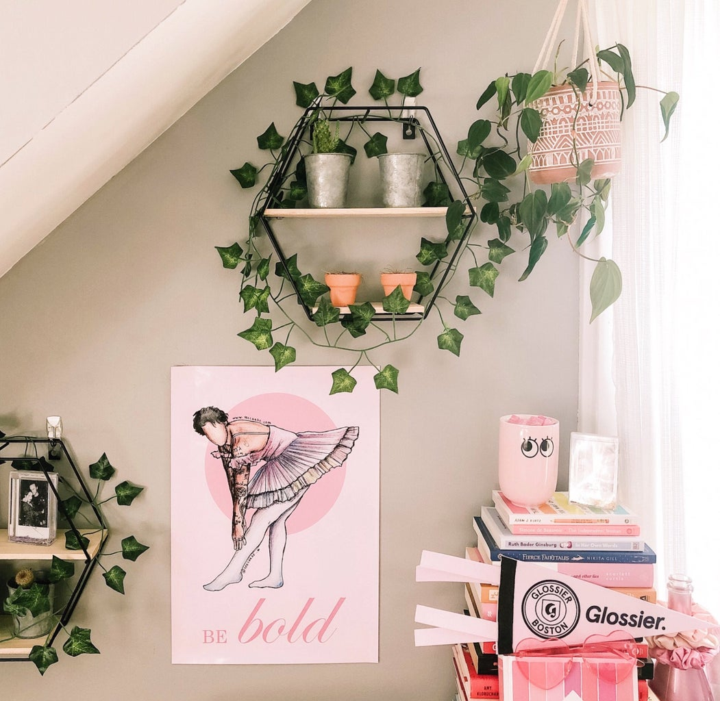 interior design of bedroom with floating shelves and poster