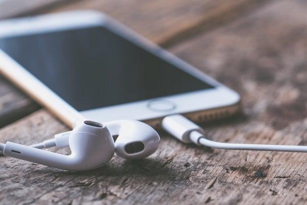 iPhone with headphones on desk
