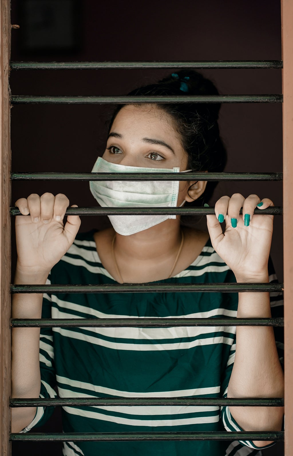 stuck indoors wearing mask by Pexels