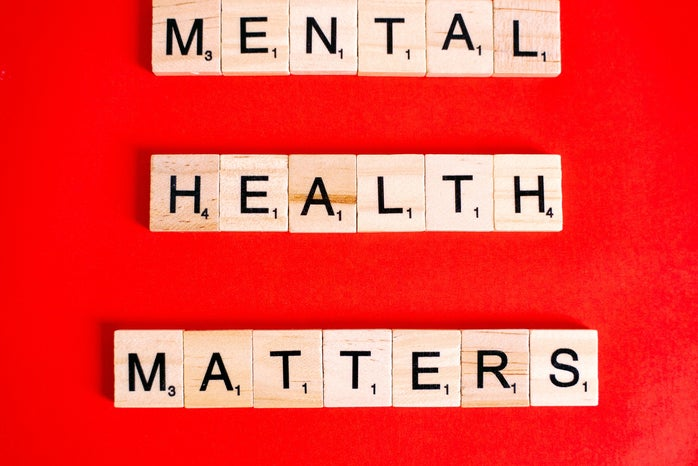 """block letters spelling out """"mental health matters"""" on a red background"""