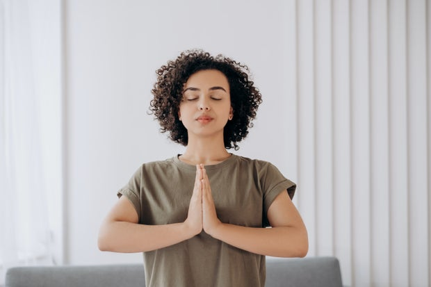 Woman meditates with her eyes closed