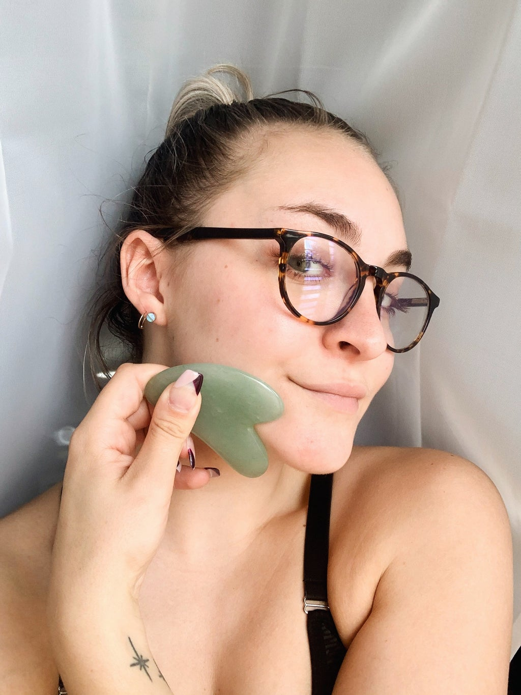 picture of me using my gua sha tool
