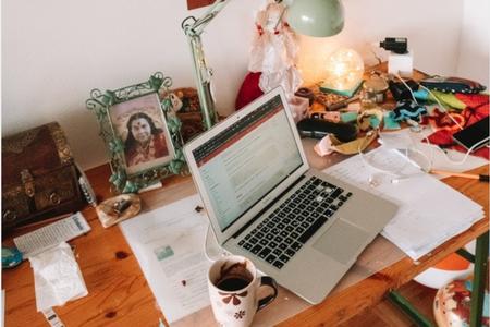 work space with computer and coffee mug