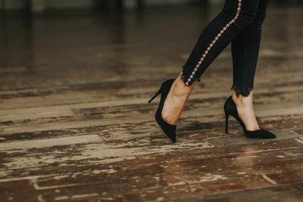 Black Heels on wood floor