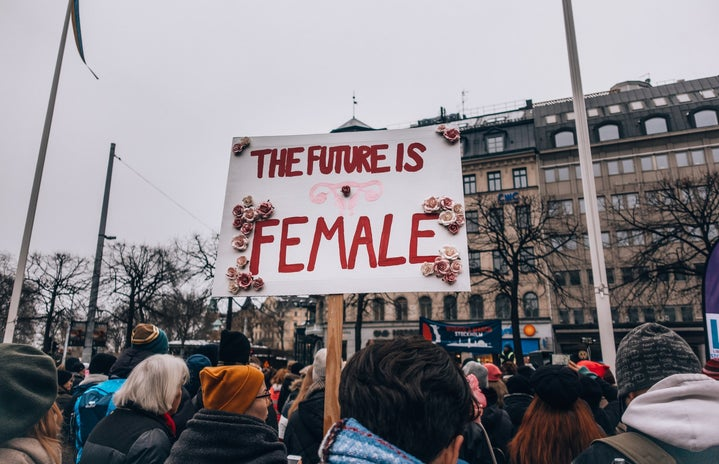 """Protester holds """"The future is female"""" sign in Sweden"""