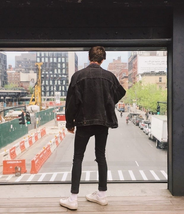 young man wearing black jean jacket