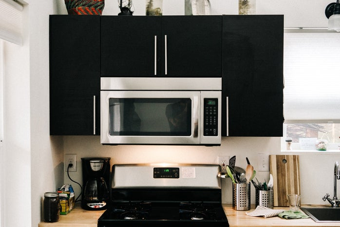 Kitchen with microwave and stove