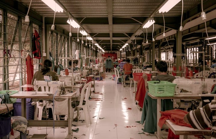 workers in factory displaying the working conditions in the fast fashion industry