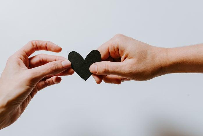 hands holding paper heart