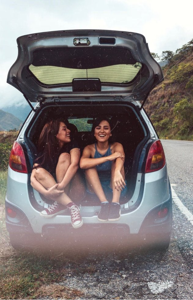 Picture of two friends in back of car