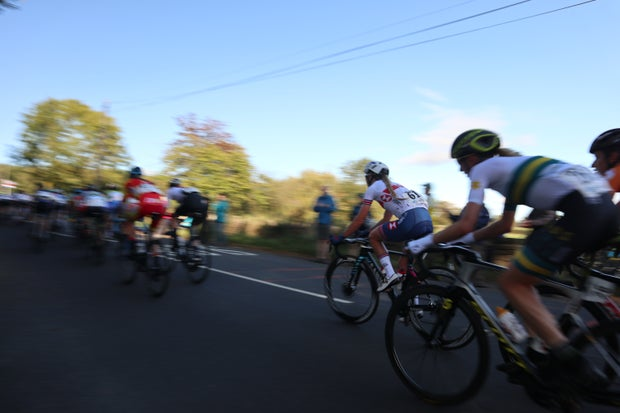 A group of women cycling competitively