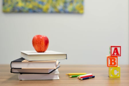 Apple on teacher's desk
