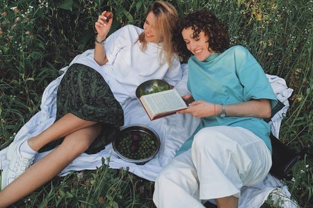 Two women having a picnic in the grass