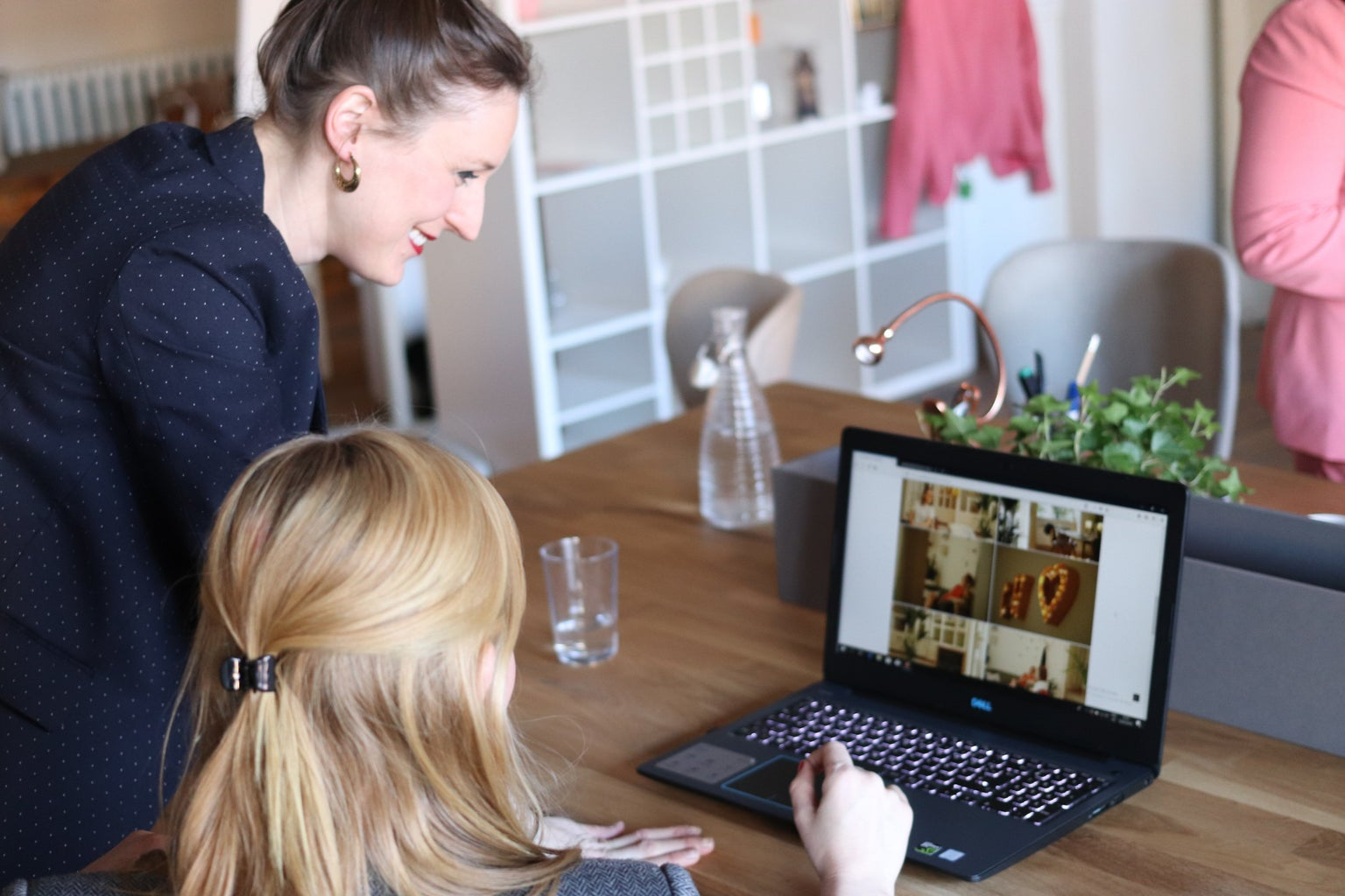 Woman with manager looking at laptop