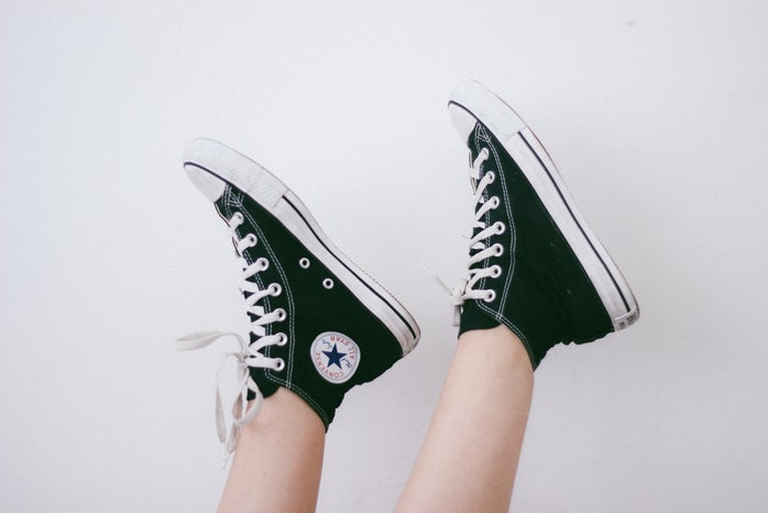 person wearing a pair of Converse sneakers