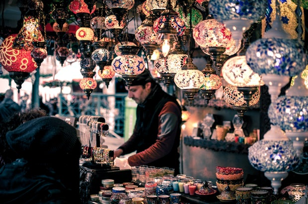 A man in a local market in turkey selling items