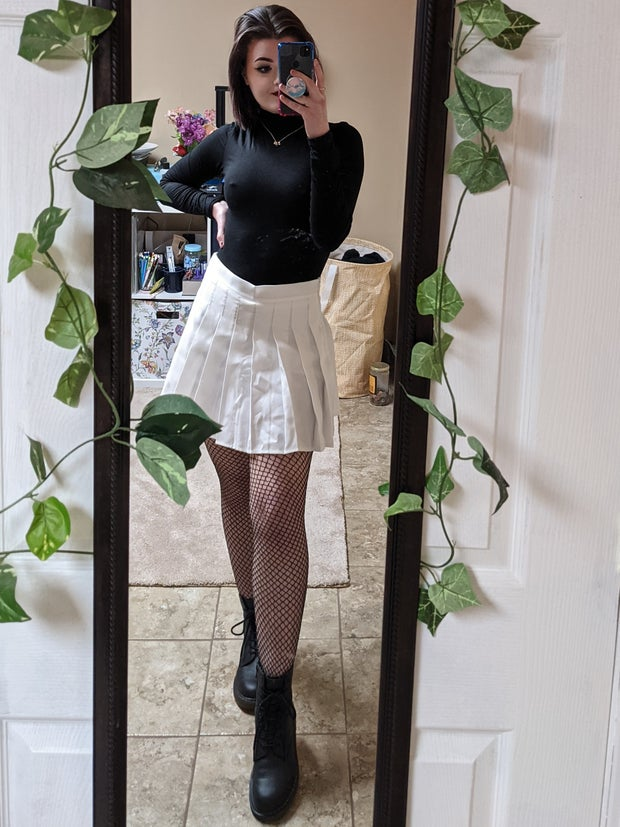 Mirror selfie to show one way of styling a tennis skirt, reuploaded because of image distortion