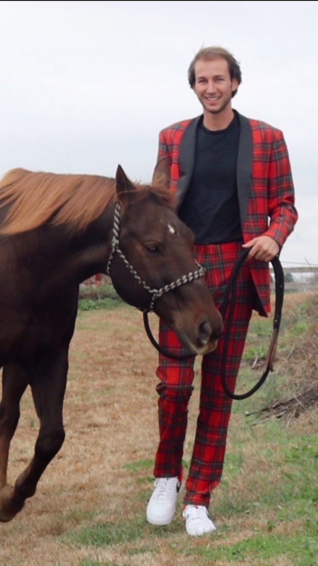 young man with plaid outfit