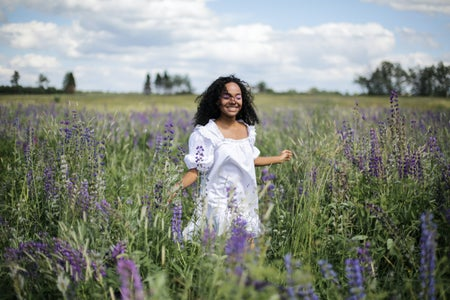 woman in field full of lavender