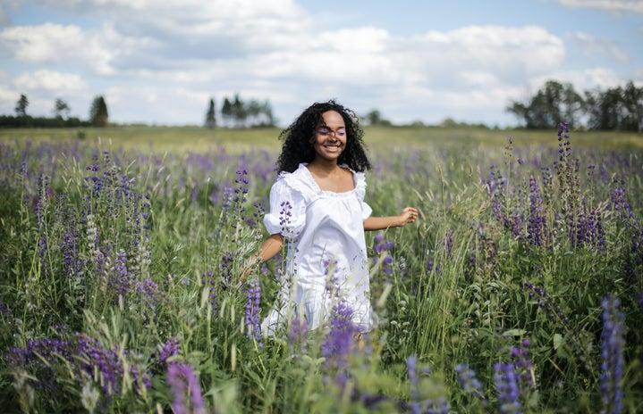 woman in field full of lavender