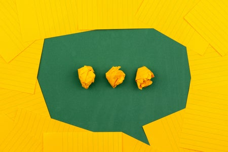 green speech bubble with yellow dots made of paper
