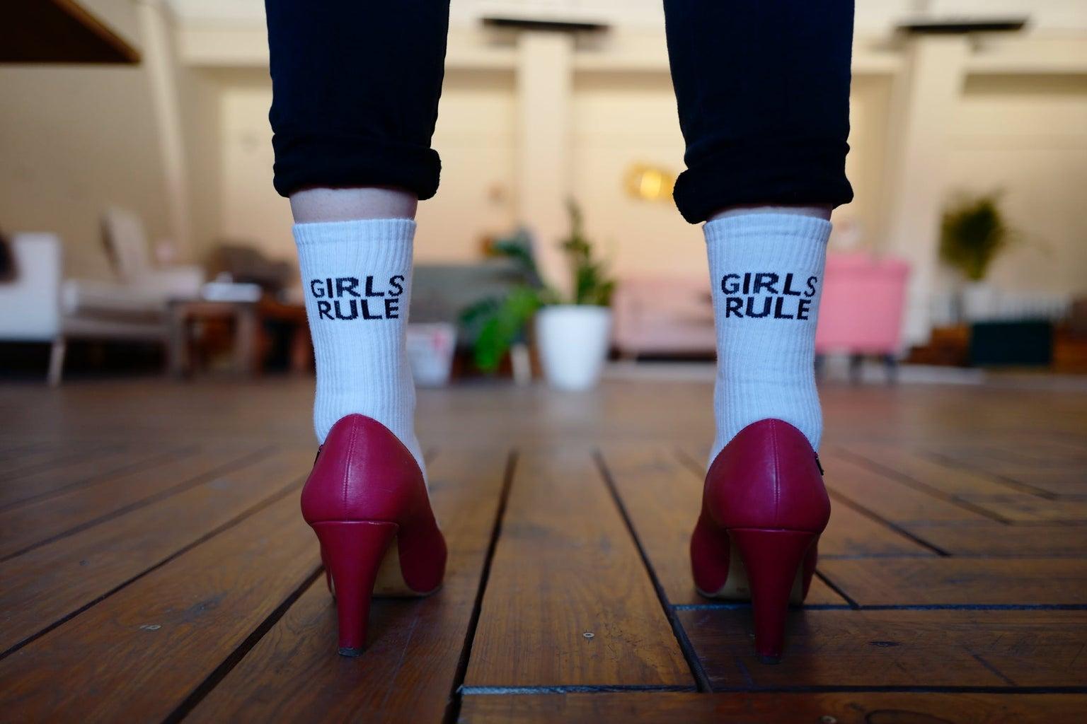 girls rule written on socks by Pexels