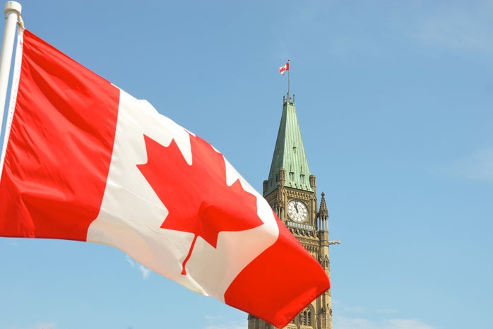 Canadian flag flying at parliament building in Ottawa ON Canada