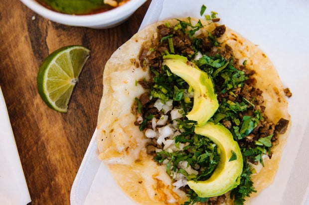 a taco with a lime shot from above