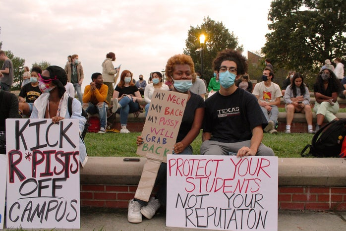 Student protestors in Columbia, Mo., hold signs at a protest against sexual assault and rape on campus.