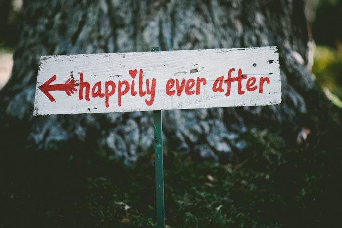 """White and red sign saying \""""happily ever after\"""" with arrow pointing left"""
