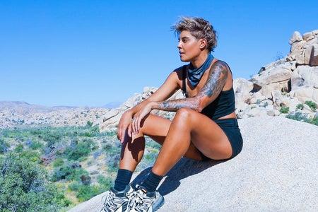 Hannah Rad sitting on a rock