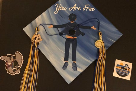 Graduation cap with stickers and tassels