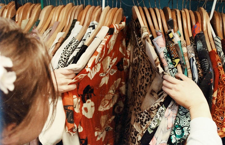 Person looking through rack of clothes