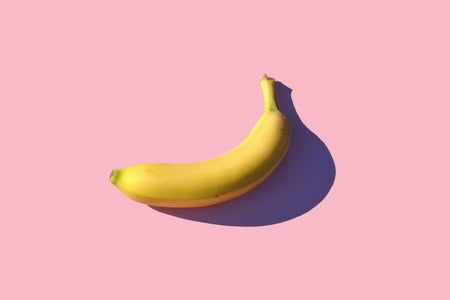 yellow banana on a pink background