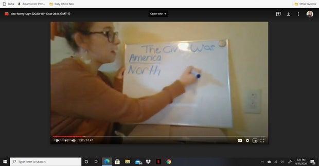 Woman teaching a class on Whiteboard