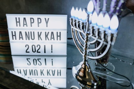 happy hanukkah 2021 sign and menorah
