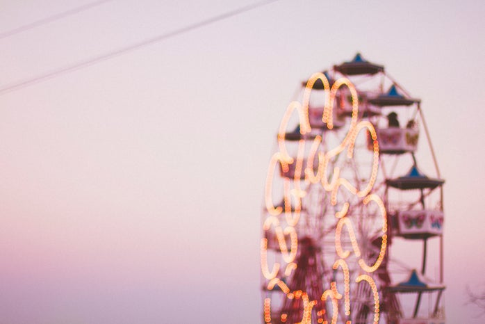 selective focus photograph of a ferris wheel against a pink sky