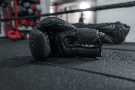 black boxing gloves in a practice boxing