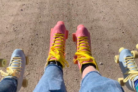 Three pairs of roller skates