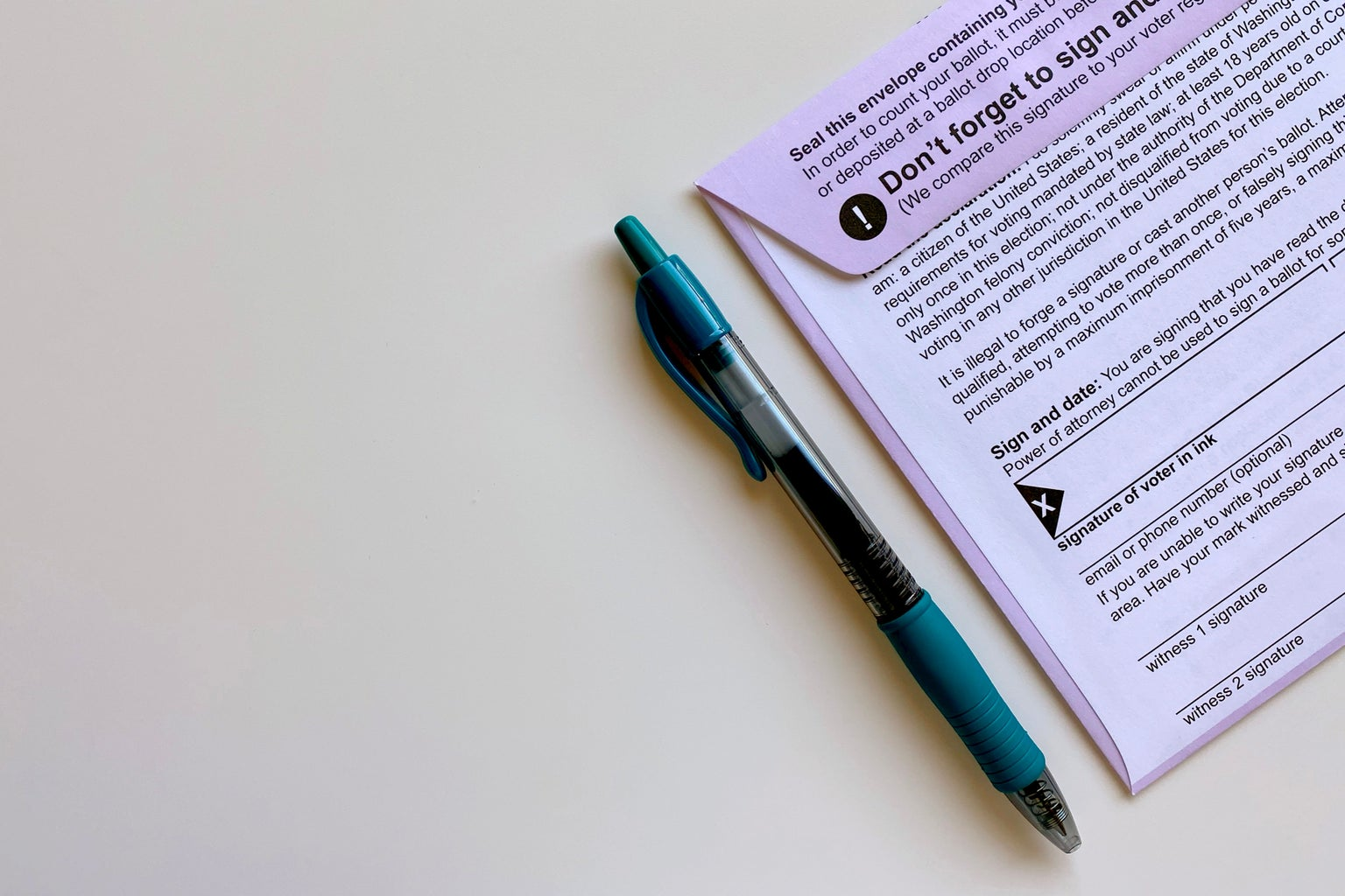 mail in ballot envelope with pen