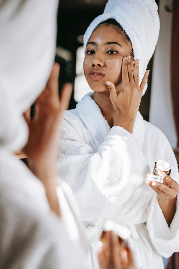 woman applying skin care