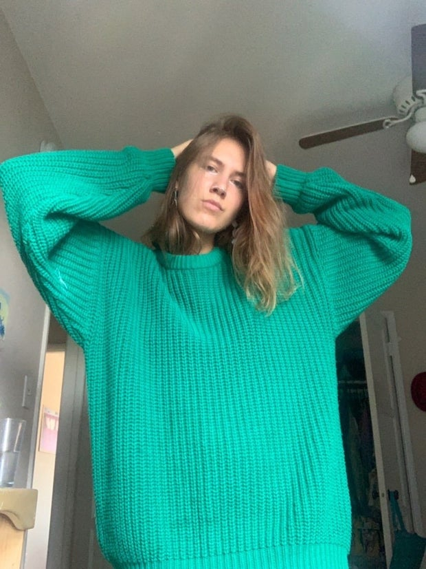 young woman wearing turquoise sweater