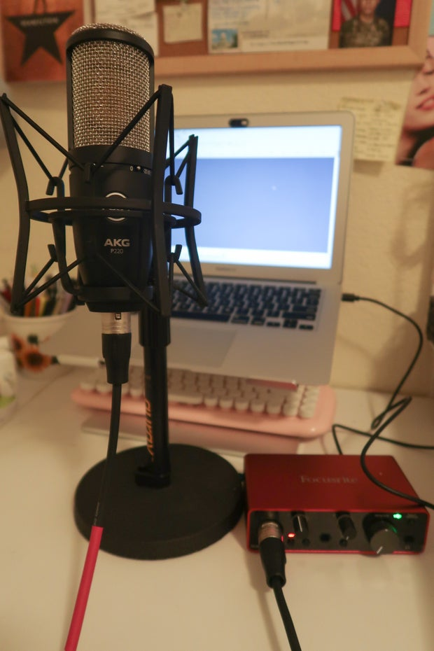 a small recording setup in a bedroom