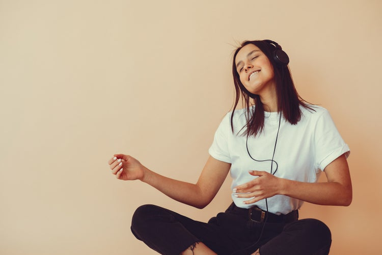 woman listening to music and dancing