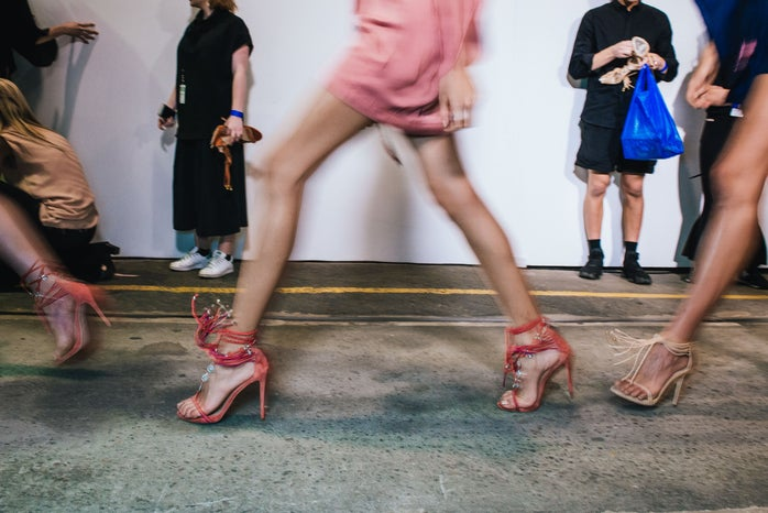 Models rushing to the runway, backstage at Mercedes-Benz Fashion Week Australia