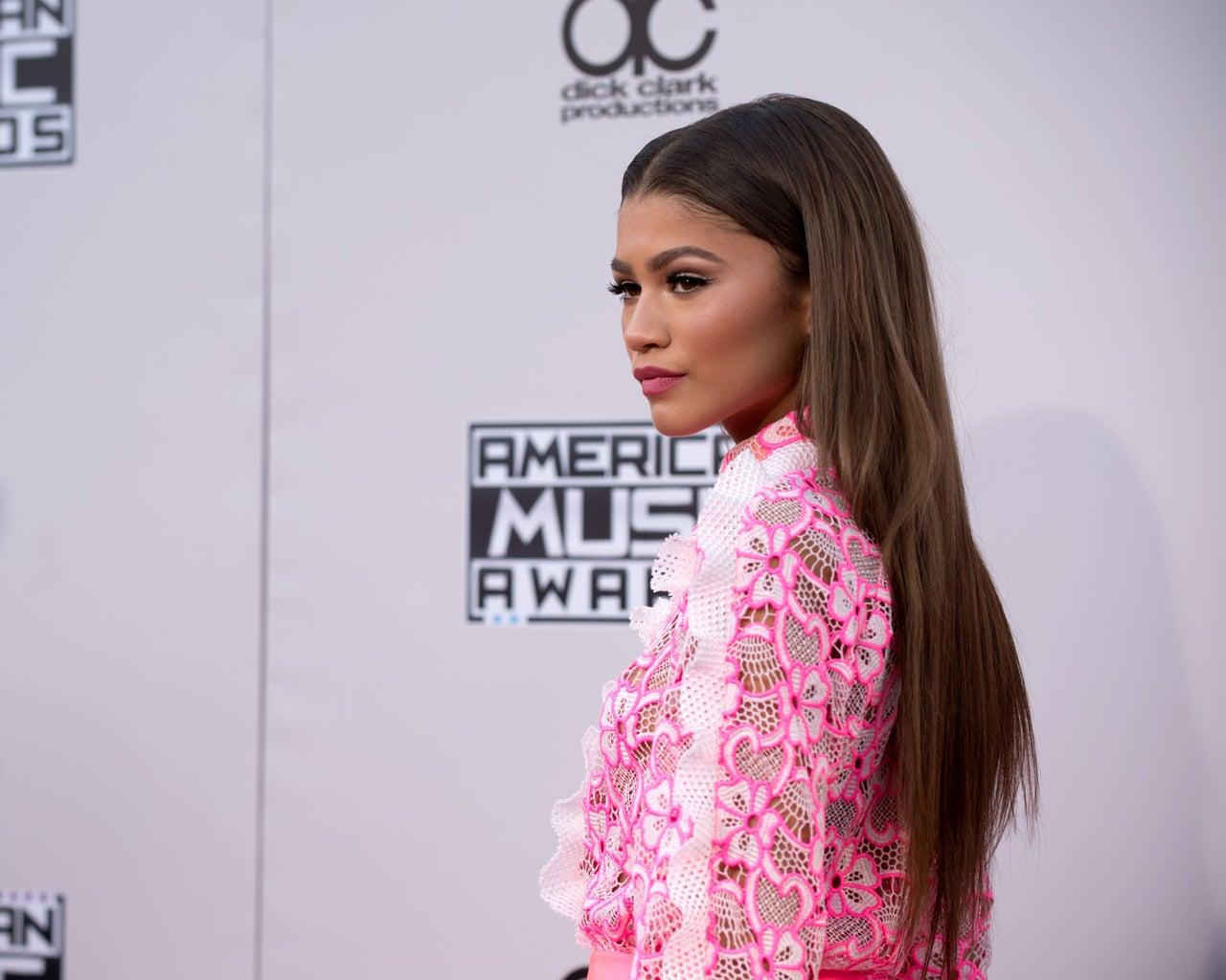 Zendaya wearing pink posing at a red carpet event
