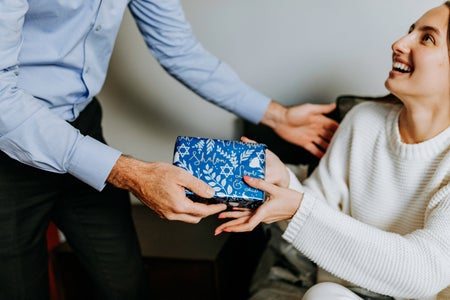 woman receiving wrapped hanukkah present