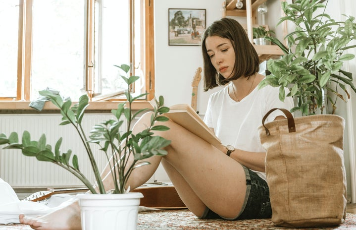 Girl studying surrounded by plants